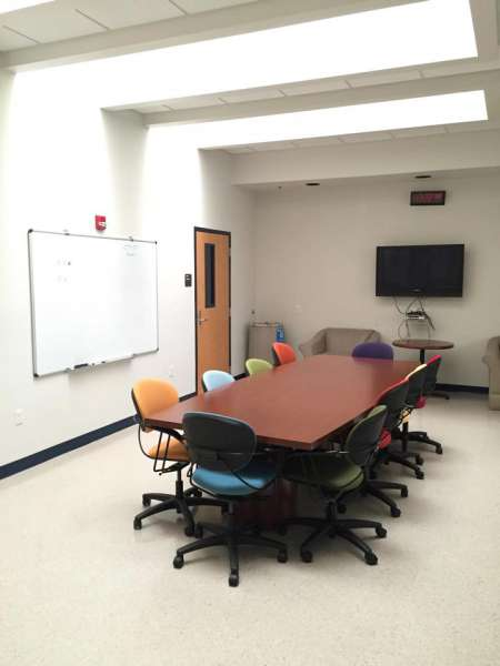 room 310 conference table and whiteboard